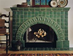 My VERY favorite is this tile in an arch pattern.   not in this green---in sage or in gray.  The arch  might make it hard to get into the gas fireplace if it needs to be serviced, though...