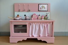 this page on ohdeedoh shows play kitchens repurposed from discard furniture. play-kitchen
