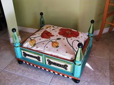 ..Functional Art - One of a Kind Hand made, hand painted dog or pet bed with Hand Painted Cushion - Turquoise-Floral-Dog Bone. $400.00, via Etsy.