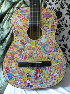 Lisa Frank Sticker Covered Acoustic Guitar.