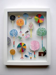 framed paper art: trees and house