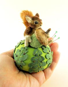 """I ❤ pincushions . . . OOAK 2013 Janie Comito Miniature Squirrel, Oak Leaf Pin cushion & Acorn- He is hand sewn from dense pile upholstery velvet, & sits 1 3/4"""" tall & is wire armatured with three way jointed head & arms & firmly stuffed with wool. His fur is hand detailed (tinted) to give him realistic character. The ears are upholstery velvet bonded to ultra suede; his eyes are black onyx beads. The tail is mohair plush. He is sewn firmly to the pin cushion base. ~By Janie Comito…"""