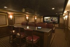Traditional media room.  I like the idea of a bar behind the chairs, reminds me of box seats at the stadium.