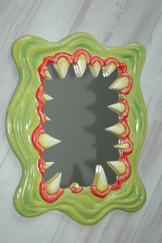 New Mirrors in the form of  Monster Mouth, decorative hand carved and painted - original wall art by Funky Mirrors.