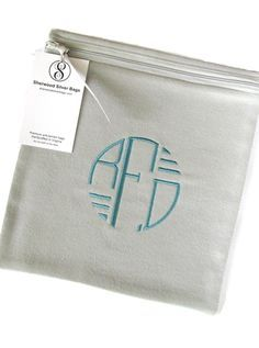 """8""""x8"""" anti-tarnish bags in light gray with medium turquoise embroidered monogram from the Art Deco collection.  Find it on Etsy at SherwoodSilverBags."""