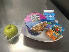 A healthy breakfast of Raisin Bran Crunch, fresh fruit and milk served in Loudoun County Schools, VA.