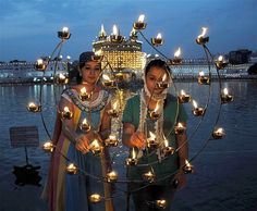 Devotees light candles at the Golden Temple during the Baisakhi festival, which celebrates Sikh New Year & the founding of the Sikh community, in Amritsar, India, on April 14.