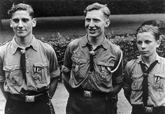 Three Hitler Youth (Hitlerjugend) flak crew members attend a ceremony where they will be decorated for fulfilling their commitments in defense or rescue. Hamburg, Germany. June 1943.