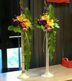 Cute orchid arrangements in tower vases Tropical Floral Arrangements, Large Flower Arrangements, Flower Arrangement Designs, Orchid Arrangements, Flower Centerpieces, Large Flowers, Flower Decorations, Wedding Decorations, Altar Flowers