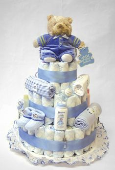 diaper cake with a few other essentials, great babyshower idea!