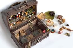 Brownie made of wooden beads and rods, of the still. Hair fibers from corn. The arrangement of the pantry used metal, mirror and glass, paper, cotton, silk, linen, bamboo, shell nuts, sunflower seeds, acorn hat and a variety of herbs, blossoms and seeds (covered with frosted acrylic lacquer). All that on the lid of the trunk - glued, the rest can be moved and removed. Chest fit into the pantry for doll house 1:12 as a road game for the house neat playing kids or as a gift for newlyweds or…