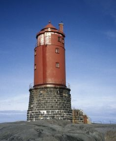 Kya Lighthouse is located on a tiny islet in the Norwegian Sea about 10 miles northwest of Sandviksberget, Norway. The keeper's quarters are located in the round stone base. Lighthouse Lighting, Lighthouse Painting, Trondheim, Bergen, Oslo, Beacon Of Light, Water Tower, Sea And Ocean, Small Island