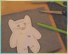 Felt and paint-on-fabric cat