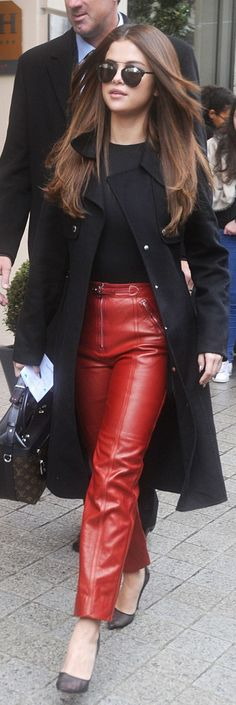 Selena Gomez: Sunglasses – Dior  Shirt – Wolford  Pants and purse Louis Vuitton  Shoes – Soebedar