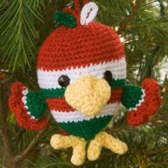Holiday Bird Ornament free crochet pattern at http://www.favecrafts.com/Crochet-for-Christmas/Adorable-Holiday-Bird-Ornament-from-Red-Heart-Yarn