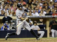 San Francisco Giants' Hunter Pence rips a bases loaded triple against the San Diego Padres in the fifth inning of a baseball game in San Diego, Saturday, July 13, 2013. (AP Photo/Lenny Ignelzi)