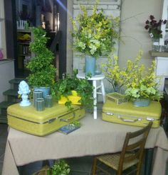 Spring Display at shop using old yellow suitcases