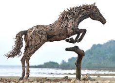 BNPS.co.uk (01202 558833) Pic: JamesDoran-Webb/BNPS ****Please use full byline**** Jumping horse on Cebu beach in the Philippines. These majestic horses galloping along a white sand beach may look real - but in fact they're made from thousands of pieces of driftwood salvaged from beach. The life-size sculptures are the work of British master craftsman James Doran-Webb and took a painstaking six months to assemble. They stand at around 6ft tall - or 16 hands in horse terms - and each is made…