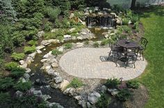 fun beautiful and safe for kids think pondless waterfall and stream, flowers, gardening, landscape, outdoor living, perennial, ponds water features, Waterfall and stream are viewed from this patio lounging space