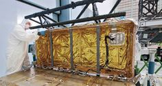 """This photo shows the James Webb Space Telescope's """"IEC"""" all wrapped up in a thermal blanket, and looking like a holiday package at a cleanroom in NASA's Goddard Space Flight Center in Greenbelt, Md.    The Integrated Science Instrument Module (ISIM) Electronics Compartment or """"IEC"""" houses all of the electronics responsible for control, data handling, and telemetry for the Webb telescope's scientific instruments."""