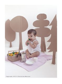 Creative mom captures her baby girl's whimsy in photos using the simplest material: cardboard.