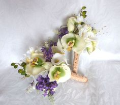 Orchid wedding bouquet green and creme orchid and rose with lilacs bouquet and boutonniere set by ChurchMouseCreations on Etsy https://www.etsy.com/listing/127971282/orchid-wedding-bouquet-green-and-creme