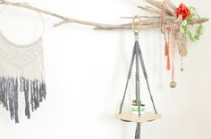Catch all your peaceful dreams with this dramatic Macrame dream catcher. This stunning dream catcher wall hanging is a beautiful statement of the bohemian style, Made of Bemboo hoop and cotton rope  27 X 11 70cm X 27cm CUSTOM ORDERS: Want a smaller or larger size? Or a different style that represents you or a loved one? Just send me a convo.  Please contact me for any questions or suggestions.