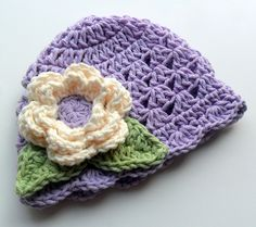 Crochet baby Hat, Hand Crocheted Scalloped Beanie Hat for infant/toddler girls, Lavender with Cream Flower, Sage Green Leaves, MADE TO ORDER. $22.00, via Etsy.