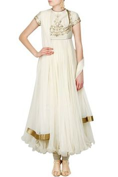 Featuring a fit and flare ivory jewel neck anarkali appliqued with golden sequins embroidery on yoke and side potli buttons . It has a heavy chanderi bodice and a chiffon flare. It comes along with a matching net dupatta and a heavy foile churidar with draw string waist band By ROHIT BAL. Shop now at www.carmaonlineshop.com. #carma #carmaonline  #indian #designer #ROHITBAL #luxuary #instyle #couture ##ethnic  #indianwear  #fashiondiary #fashiondaily #bride #smile #love #elegance #white…