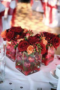 Grand Prix roses, cherry brandy roses, hyericum berries and crab apples (weddingmagazine.co.uk)