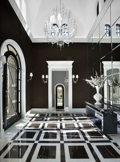 Black & White entry - Luxe Interiors Salcito foyer marble floor pattern mirrored walls
