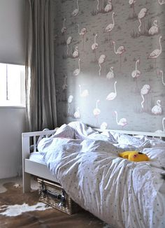 flamingos. can be found here: http://www.wallpaperdirect.co.uk/products/cole-son/flamingos/25186