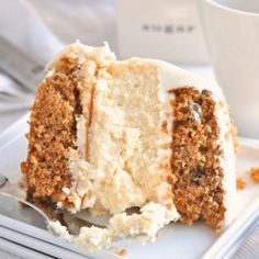 a creamy layer of cheesecake is sandwiched between 2 layers of carrot cake & topped with cream cheese frosting.
