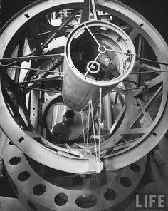 Astronomer Edwin Hubble pictured inside the workings of the huge Mount Palomar telescope, Mount Palomar, California, by J. R. Eyerman, 1950