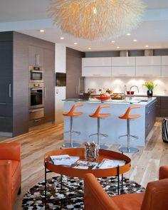 une cuisine moderne et ouverte sur la salle de séjour