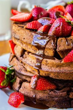 Delicious chocolate waffles with strawberry and chocolate sauce.