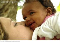 Caucasian mother and her mixed race baby girl--I wish we were all mixed up race wise--we'd all be so beautiful and interesting and perhaps more tolerant!