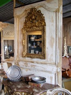 a brocante booth with gilded mirror and wall display