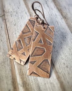"""Copper earrings with hand drawn, etched design. Approx 2"""" in length and very light weight."""