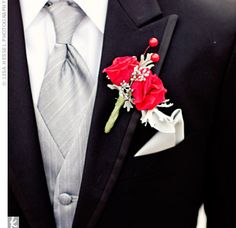 Red roses, silver brunia and dusty miller accented Tim's black suit and silver vest and tie combo.