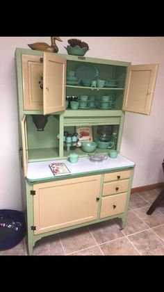 When my Great Grandaddy passed away, my momma got this exact kitchen hosier from is old farm house in Alabama and refurbished it to its former beauty. It's my favorite family piece! Vintage Kitchen Cabinets 1950s, Vintage Cabinets, Cabinet, Vintage Kitchen, Hoosier Cabinet, Vintage Kitchen Cabinets, Hoosier Cabinets, Retro Kitchen Decor, Kitchen Cabinets