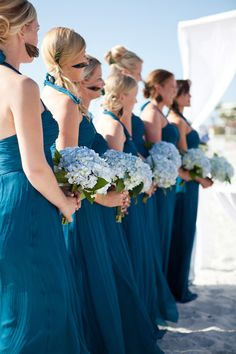 These wedding photos are making me rethink my roses and delphinium orchids...blue hydrangeas are gorgeous!
