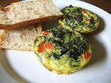 Mini Spinach Frittatas -- Make them ahead and pop them in the microwave for 20-40 seconds or pop them in the toaster oven for about a minute.  Great way to have a protein breakfast on the go!