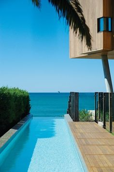 The terrace and lap pool reach out  to the ocean.