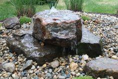 Bubbling rock with hidden reservoir.  Landscaping ideas