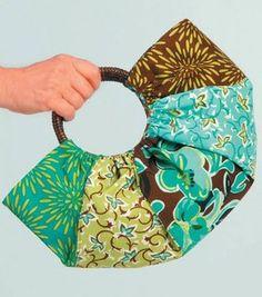 Cute handbag - would need great round handles...  PDF found at http://www.joann.com/static/project/0809/P319777_stonehill_pieced_handbag.pdf