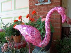 Bejeweled Flamingo!  I glued pink rhinstones to my faded plastic flamingo, then used pink grout and sealed with a clear coat.  Love It!