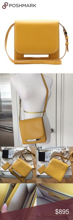 """The Row Classic Shoulder Bag Yellow Inside normal wear marks see photo.  Outside, strap, metal parts are good. Can be shoulder or crossbody. Come with original dust bag / mirror.  The Classic shoulder bag from The Row lives up to its name in enduring leather and a minimalist, square design. Adjustable strap, 19"""" drop. Flap opening; push-lock clasp. Gusseted sides expand. Two interior compartments; zip and open pockets. Hand mirror in mirror sleeve included. Leather lining. 7""""H x 7""""W x 2"""" D…"""