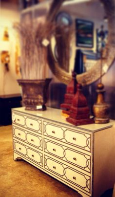 You can dress up your home with this Nailhead Dresser. It is chic as well as versatile.
