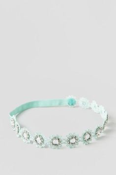 The Lacey Headband is as sweet as it can get. The headband is made with fancy mint color flower crochet adorned with large crystal rhinestones surrounded by small crystal rhinestones